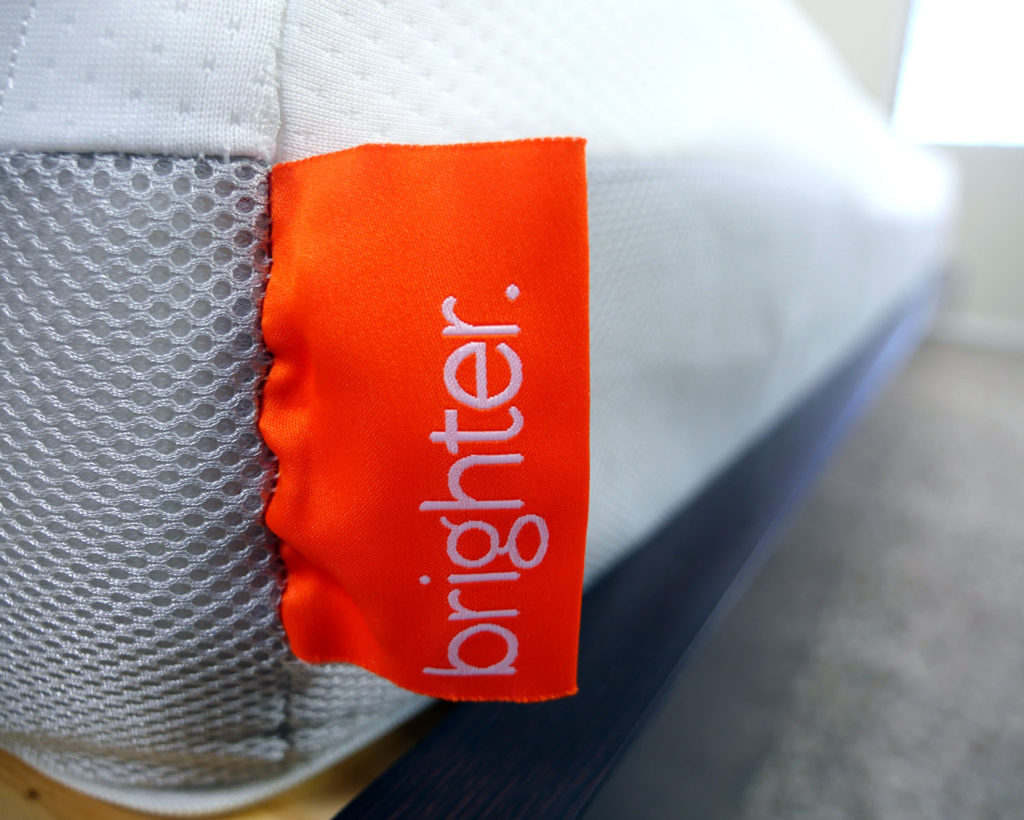 Ultra close up shot of the Brighter mattress logo